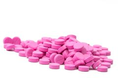 Pile of pink tablets pills isolated on white background with clipping path. Stock Image