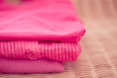 Pile of pink tops, clothes and fashion series. Fashion/shopping inspired shot of a pile of blue clothes Royalty Free Stock Image