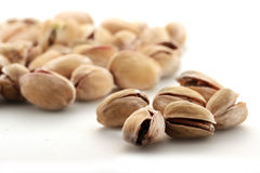 A pile of pistachio nuts stock photo