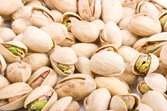 Pile of pistachio nuts close up Stock Photo