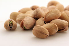A pile of pistachio nuts stock photos