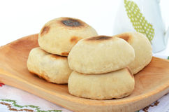 A pile of pita bread on a wood plate Royalty Free Stock Photo