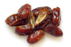 A pile of pitted dried dates. On white background Royalty Free Stock Photo