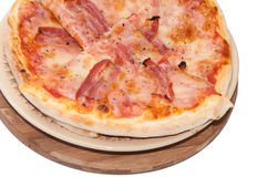 Pile of pizza with bacon on the plate Stock Images