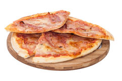 Pile of pizza with bacon slices on the wooden board Stock Photography