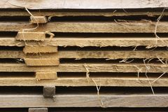 A pile of planks at a sawmill. Closeup of a pile of planks at a sawmill. The distance between the planks allows them to dry properly Royalty Free Stock Images