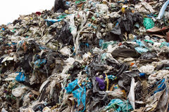 Pile of plastic bags and other refined petroleum products dumped in landfill. Garbage heap gives infiltrate into ground Stock Image