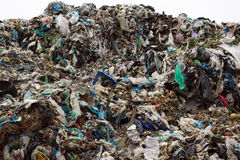 Pile of plastic bags and other refined petroleum products dumped in landfill. Garbage heap gives infiltrate into ground Stock Photography
