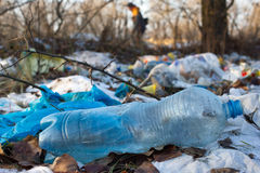 Pile of plastic bags and other refined petroleum products dumped in landfill. Garbage heap gives infiltrate into ground Stock Photos
