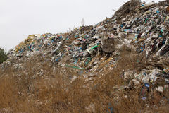 Pile of plastic bags and other refined petroleum products dumped in landfill. Garbage heap gives infiltrate into ground. Waste sor Royalty Free Stock Photos