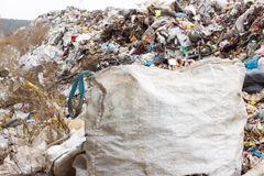 Pile of plastic bags and other refined petroleum products dumped in landfill. Garbage heap gives infiltrate into ground. Waste sor Stock Image