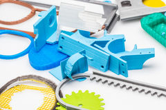 Pile of plastic laying on a white table. Not all 3D printers use the same technology. There are several ways to print and all those available are additive Stock Image