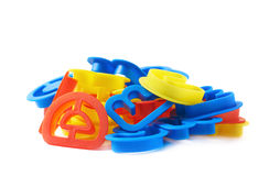 Pile of plastic letter forms isolated Royalty Free Stock Image
