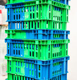 Pile of Plastic Pallets Blue And Gray Color Stacked Beside A Store. Royalty Free Stock Images