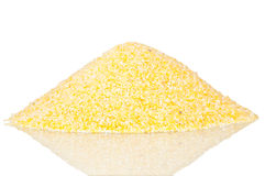 Pile of polenta. Over a reflective white background Royalty Free Stock Images