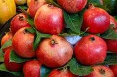Pile of pomegranates. A pile of pomegranates on a market stall Stock Photo