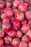Pile pomegranates in the box at the market. Pile pomegranates in a box at the market stock images