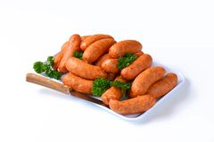Pile of pork sausages on plate Stock Image