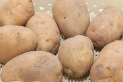 Pile of potato in the basket. Close up of pile of potato in the basket Stock Photo