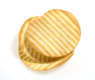 Pile of potato chips. Stack of rippled potato chips isolated on white background Royalty Free Stock Photos