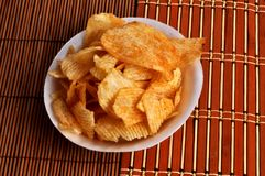 Pile potato chips. Camera shot on pile potato chips with mat texture background Royalty Free Stock Photo