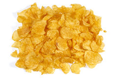 Pile of potato chips. A pile of potato chips in light back seen from above Stock Image