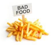 Pile of potato fries on kraft paper. Bad food Royalty Free Stock Photos