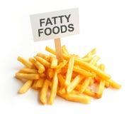 Pile of potato fries on kraft paper. Fatty food Stock Image