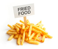 Pile of potato fries on kraft paper. Fried food Stock Photography