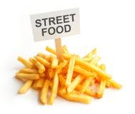 Pile of potato fries on kraft paper. street food. French Stock Photos