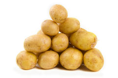 Pile of potatoes. Isolated on white Stock Photos