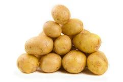 Pile of potatoes. Isolated on white stock photos