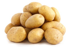 Pile of potatoes arranged on white Royalty Free Stock Images