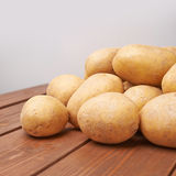 Pile of potatoes over the wooden surface Royalty Free Stock Image