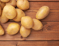 Pile of potatoes over the wooden surface Royalty Free Stock Photography