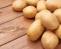 Pile of potatoes over the wooden surface Stock Image
