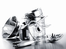 Pile of pots and pans against white royalty free stock photo