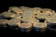 Pile on the pounds. A pile of �1 coins stock image