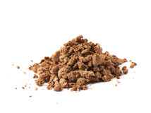 Pile of praline crumbles. Pile of chocolate praline candy crumbles isolated over the white background Royalty Free Stock Images