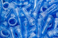 The pile of the preform shape of plastic bottle products. The raw material for PET bottle manufacturing process stock photography