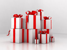 Pile of presents. Decorated with red ribbons and bows, white studio background Royalty Free Stock Images
