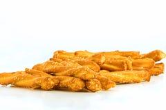 Pile of pretzels. Pile of pretzel sticks on white royalty free stock photo