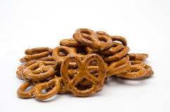 A Pile of Pretzels. On isolate white showing salt and cook marks Stock Photos