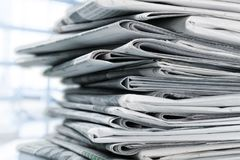 Pile of printed newspapers on white background. Print media pile of newspapers paper stack paper isolated closeup heap Stock Photos