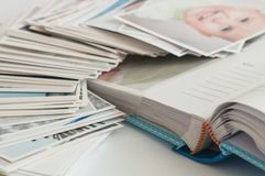 Pile of printed photographs lying in disorder stock images