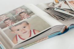 Pile of printed photographs lying in disorder stock photography