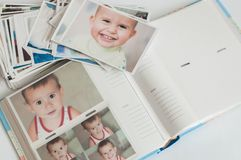 Pile of printed photographs lying in disorder stock photos