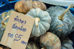Pile of pumpkin in marke Thailand, The price tag in Thai languag Royalty Free Stock Photos