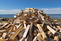 Pile of punctured firewood. On the background of the sea and sky stock image