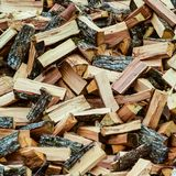 A pile of punctured firewood. stock photo